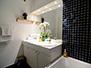 Bathroom 1 with two sinks and a bathtub