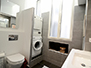 Second bathroom with washer and dryer