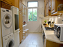 Overall view of the kitchen with washer and dryer