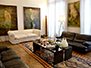 Spacious living room filled with artworks. Welcome to Paris!