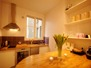 The fully equipped kitchen includes a dining island for your home-cooked Parisian meals.